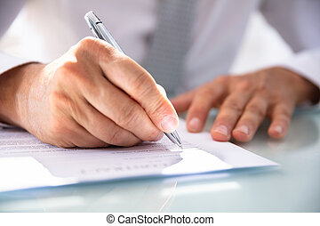 Businessman Filling Contract Form