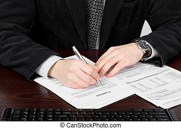 Businessman filling out contract form