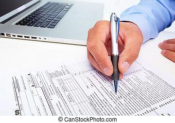 Businessman filling the form.