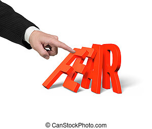 Businessman finger pushing domino of red fear word falling