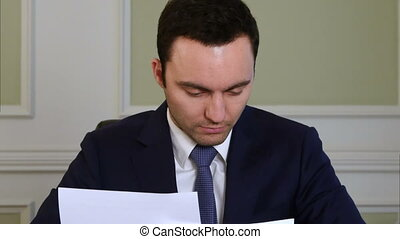 Businessman finishes working on documents and walks away