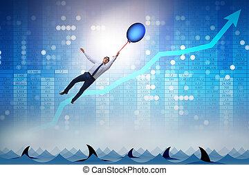 Businessman flying holding balloon