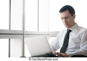 Businessman focusing on work