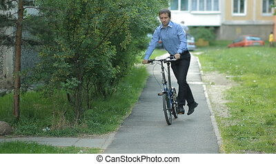 Businessman folding bicycle
