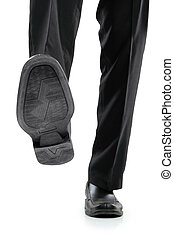 businessman foot stepping - Business man in black shoes ...