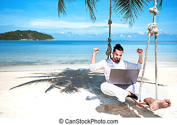 Businessman freelance on beach with laptop