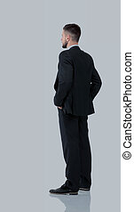 Businessman from the back - looking at something over a...