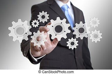 Businessman gears concept - Businessman playing with gears...