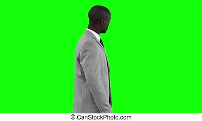 Businessman gestures while making a presentation