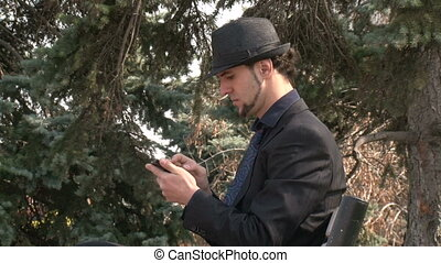 Businessman gesturing on smartphone