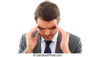 Businessman getting a headache in the office