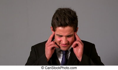 Businessman getting a headache - Businessman getting a...