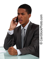 Businessman getting angry during call