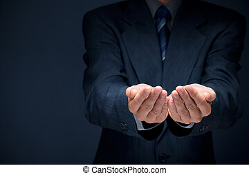 Businessman give you secret about successful business. Giving and protecting gesture. Blue formal wear and background.