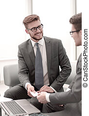 businessman gives the client a business card
