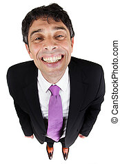 Quirky high angle portrait of a stylish businessman giving a cheesy grin with his face raised to the camera