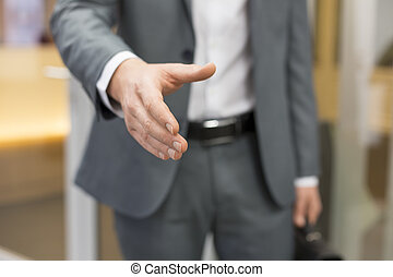Businessman giving a hand in office