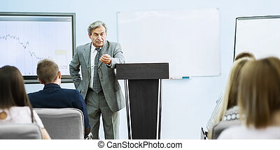 Businessman giving a presentation at the conference. teamwork concept