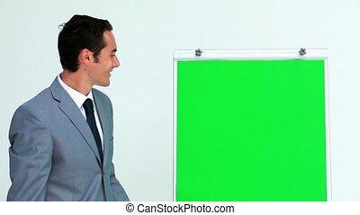 Businessman giving a presentation on a board