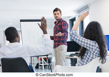 Businessman giving a presentation to his colleagues at work