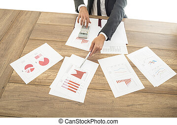 Businessman giving a presentation with graphs