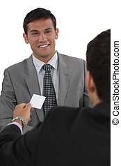 Businessman giving businesscard in a meeting