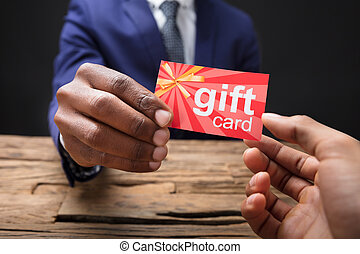 Businessman Giving Gift Card To His Partner