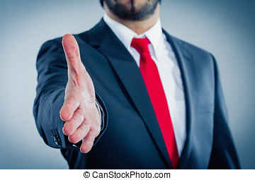 businessman giving hand for handshake mood light