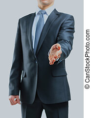 Businessman giving his hand for a handshake.