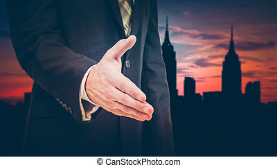 Businessman giving his hand for handshake to partner.