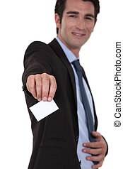 businessman giving his visit card