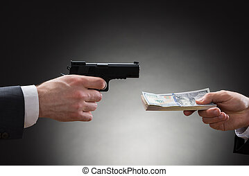 Businessman Giving Money To The Businessperson With Gun