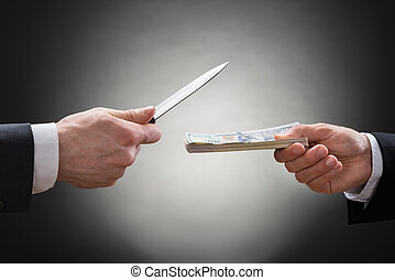 Businessman Giving Money To The Businessperson With Knife