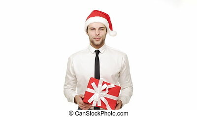 Businessman giving present to camera over isolated white background.