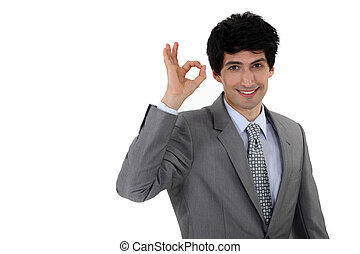 Businessman giving the a-ok sign
