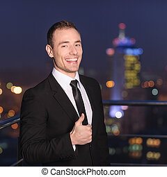 Businessman Giving the Thumbs Up - Satisfied businessman on...