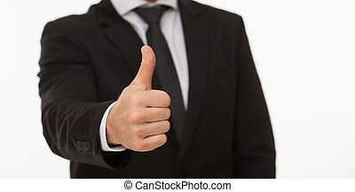 Businessman giving thumb-up