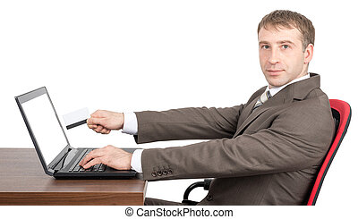 Businessman giving to laptop credit card