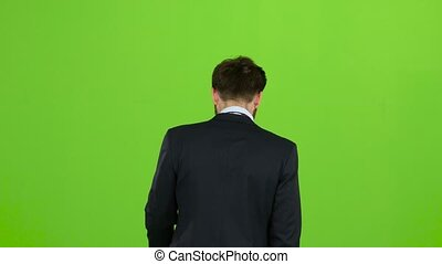 Businessman goes to work, with a diplomat he waves his hand to others. Green screen. Back view