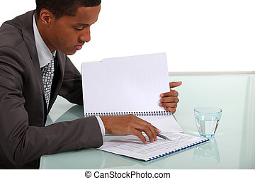 Businessman going over notes