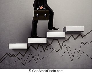 Businessman going up with line graph on wall