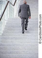 Businessman going upstairs