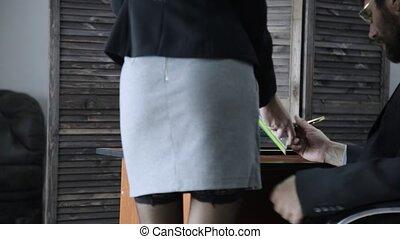 businessman grabbing a secretary buttocks. sexual harassment...
