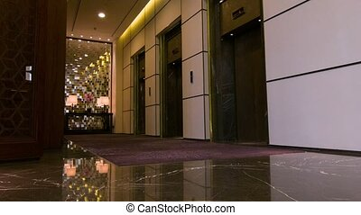 Businessman guest getting into elevator - Elevator ride. ...