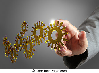 hand and gold people cogs as concept