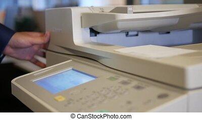 Businessman hand doing copy on office printer, 4k UHD 2160p, dolly slider shot