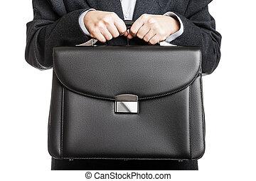 Businessman hand holding briefcase - Business man in black...