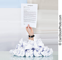 Businessman Hand Holding Contract Paper - Person Under Pile ...
