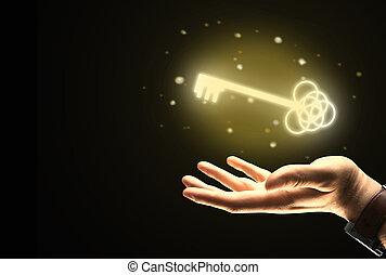 Businessman hand holding golden key