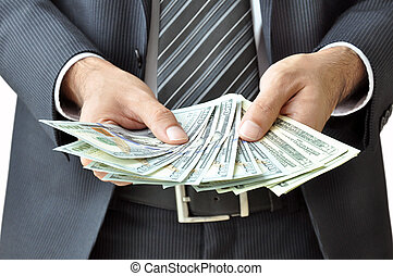 Businessman hand holding money - United States Dollars (or USD)